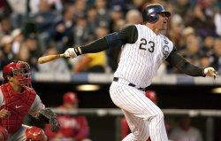Rockies Giambi Bats in a Run Against the Phillies in Denver