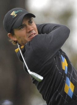 Camilo Villegas watches his drive during the final round of the 2009 Presidents Cup in San Francisco
