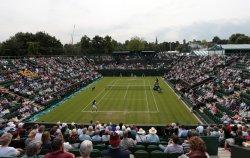 Lleyton Hewitt serves to Dustin Brown at 2013 Wimbledon Championships