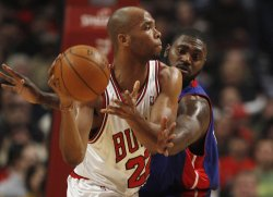 Bulls' Gibson passes as Pistons' Maxiell defends in Chicago