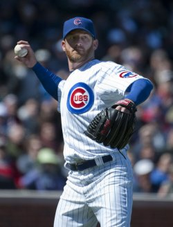 Cubs' Dempster Throws to First Base Against Brewers in Chicago