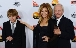 Linda Kozlowski and Paul Hogan attend G'Day USA gala with son Chance in Los Angeles