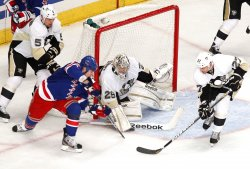 Pittsburgh Penguins goalie Marc-Andre Fleury makes a save on a shot by New York Rangers Brandon Dubinsky at Madison Square Garden in New York