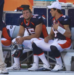Broncos BackUp Quarterbacks Tebow and Quinn Sit on the Bench in Denver