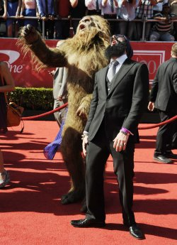 MLB player Brian Wilson of the San Francisco Giants (R) and sasquatch attends the 2012 ESPY Awards in Los Angeles