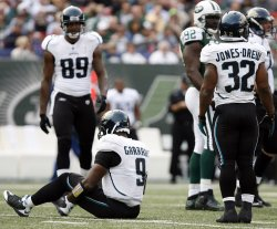 Jacksonville Jaguars David Garrard remains on the ground after a paly in the second quarter against the New York Jets in week 10 of the NFL season at Giants Stadium