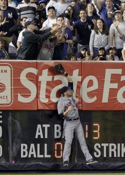 New York Mets Jason Bay leaps at Yankee Stadium in New York