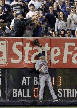 New York Mets Jason Bay leaps at Yankee Stadium in New York