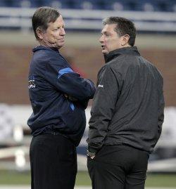 San Diego Chargers Head Coach Norv Turner alks to Detroit Lions Head Coach Jim Schwartz in Detroit