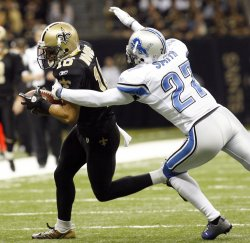 New Orleans Saints wide receiver Lance Moore picks up 4 yards against the Lions at the Mercedes-Benz Superdome