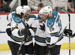 Sharks celebrate Couture goal against Blackhawks in Chicago