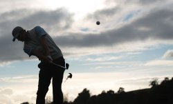 Dustin Johnson plays a shot on the first day of Ryder Cup.