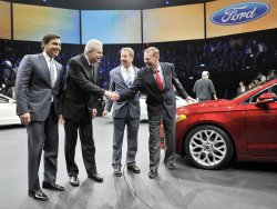 Fields, Kuzak, Ford and Mulally pose with 2013 Fusion at NAIAS in Detroit