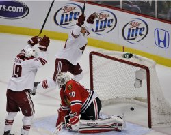 Phoenix Coyotes center Antoine Vermette (50) celebrates his goal in Chicago