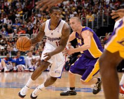 Los Angeles Clippers Eric Bledsoe drives by Los Angeles Lakers' Steve Blake in Los Angeles