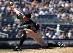 Toronto Blue Jays relief pitcher Casey Janssen throws a pitch at Yankee Stadium in New York