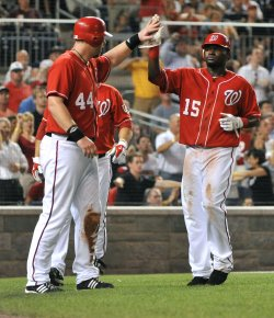 Nationals's Adam Dunn celebrates with teammate Cristian Guzman in Washington
