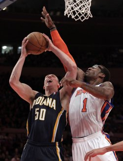 New York Knicks Amar'e Stoudemire plays defense on Indiana Pacers Tyler Hansbrough at Madison Square Garden in New York