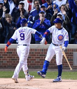 Cubs' Jay congratulates Baez after homer against Dodgers in NLCS