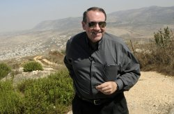 Former U.S. Presidential candidate Mike Huckabee stands near the West Bank settlement Har Bracha overlooking Nablus