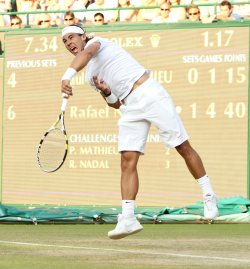 Nadal serves at the Wimbledon Championships