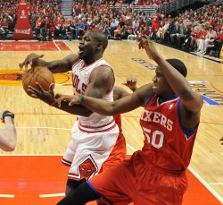 Bulls' Brewer and 76ers' Allen go for rebound during Playoff in Chicago