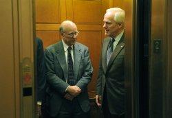 Sen. John Cornyn (R-TX) (R) and Sen. Pat Roberts (R-KS) on Capitol Hill in Washington