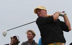 John Daly plays a tee shot.