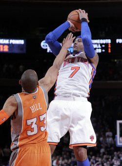 New York Knicks Carmelo Anthony shoots a jump shot over Phoenix Suns Grant Hill at Madison Square Garden in New York