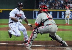 Braves' Michael Bourne scores