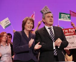 Gordon Brown and Harriet Harman stand with party members on the final day of the Labour Party Conference 2009.