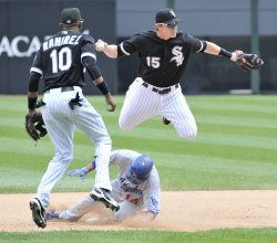 White Sox's Beckham leaps over Dodgers Carroll in Chicago