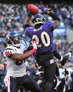 Ravens safety Ed Reed intercepts a pass intended for Texans' Andrea Johnson in Baltimore