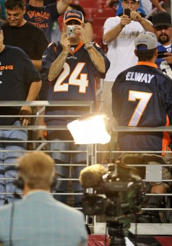 Fan takes a picture of Elway in Arizona