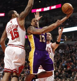 Lakers' Brown shoots as Bulls' Johnson and Miller defend in Chicago