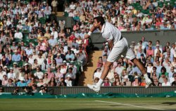 Jeremy Chardy serves at 2013 Wimbledon Championships