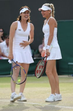 Kournikova and Hingis laugh at the Wimbledon Championships