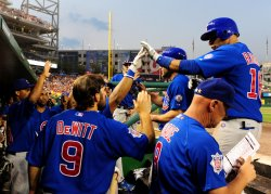 Chicago Cubs Aramis Ramirez is congratulated by teammates in Washington