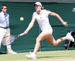Justine Henin chases the ball at the Wimbledon Championships