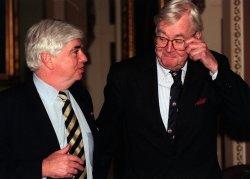 Senators Dodd and Moynihan walk to the Senate