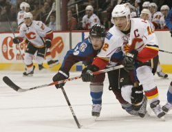 Flames Iginla and Avalanche Galiardi Battle for Position in Denver