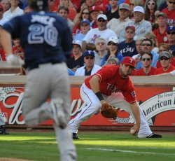 Rangers Moreland chases an overthow