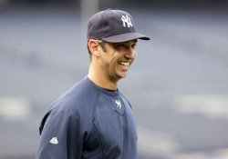 New York Yankees Jorge Posada smiles at batting practice at Yankee Stadium in New York