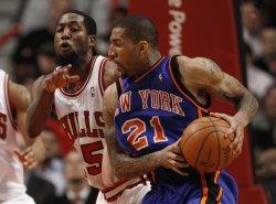 Knicks' Chandler drives on Bulls' Salmon in Chicago