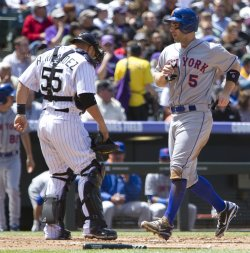 Mets Wright Scores After Reaching Base on a Two-Run Double Against the Rockies in Denver