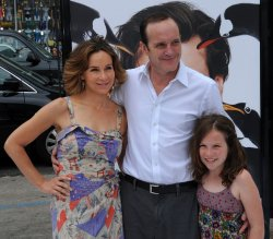 "Clark Gregg and Jennifer Grey attend the premiere of ""Mr. Popper's Penguins"" with daughter Stella in Los Angeles"