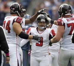 Atlanta Falcons kicker Matt Bryant (C) is congratulated by teammates after kicking a 42-yard field goal against the Seattle Seahawks.