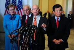 Rep. Peter DeFazio (D-OR), Rep. Marcy Kaptur (D-OH) (C), Rep. Bill Pascrell (D-NY) and Rep. David Wu (D-OR) speak in Washington