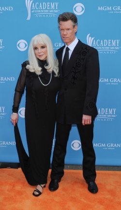 Randy Travis and his wife Elizabeth arrive at the ACM Awards in Las Vegas