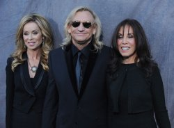 Joe Walsh arrives with wife Marjorie Bach and Olivia Trinidad Arias for the 17th annual Critics Choice Movie Awards in Los Angeles